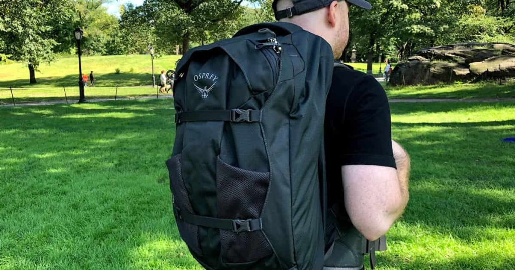 man in park with osprey backpack