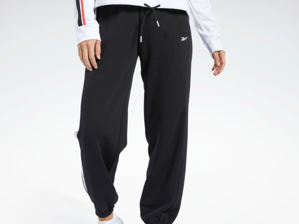 man wearing black pair of sweat pants