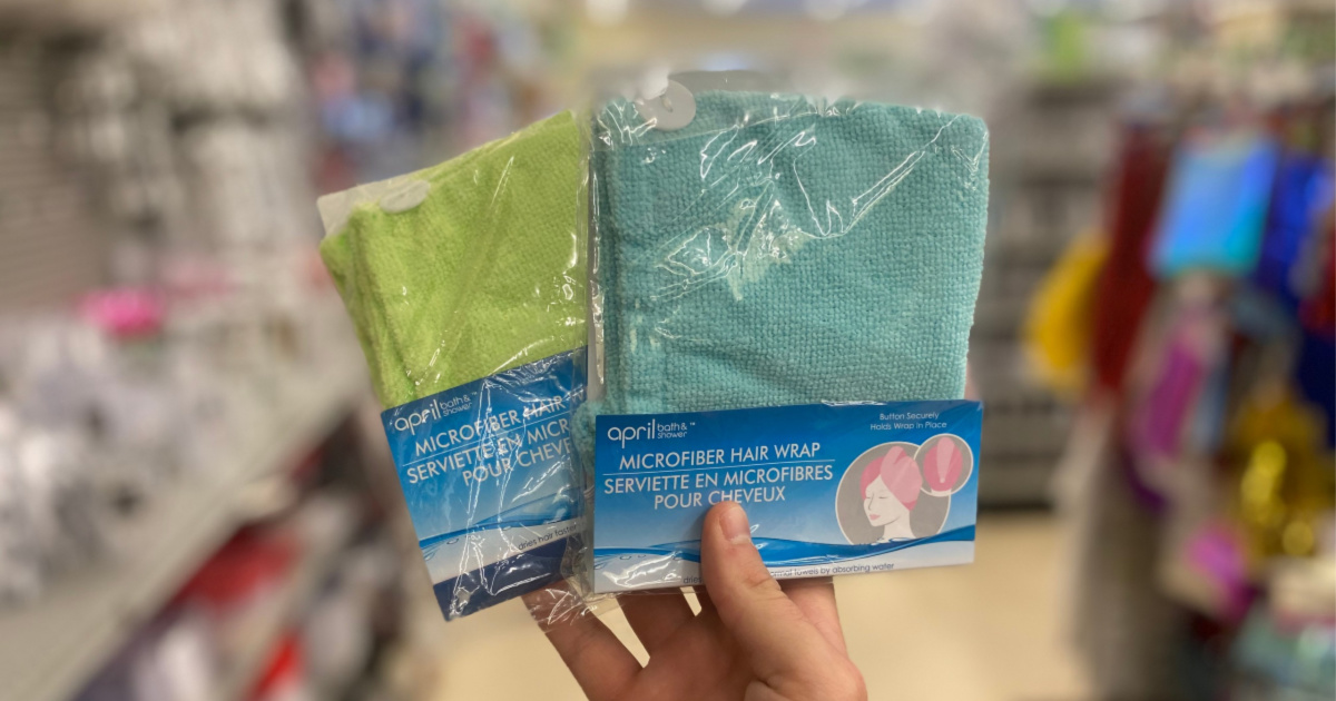 hand holding two packs of microfiber hair towels