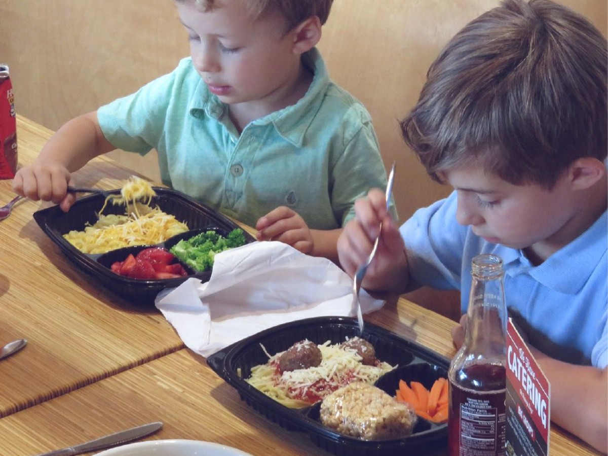 two boys eating at Noodles and Company