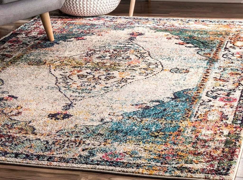 blue and cream colored medallion area rug