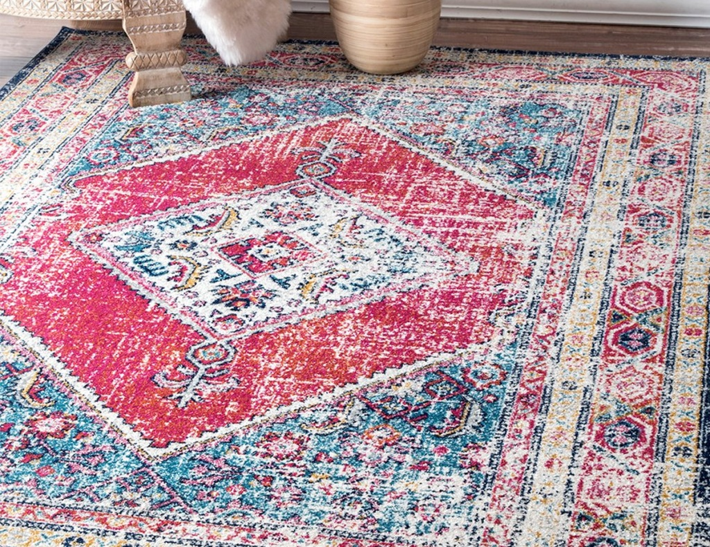 red, blue, and cream colored medallion print area rug
