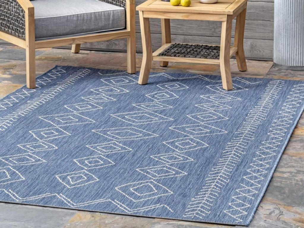 white and blue diamond rug on patio
