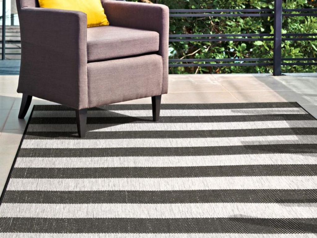black and gray outdoor area rug on patio