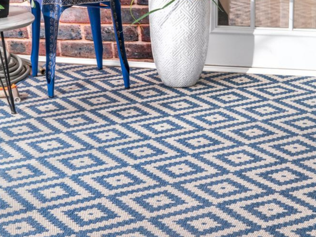 blue and white diamond rug on patio