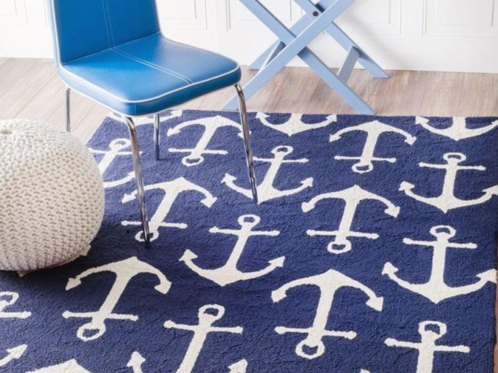 blue and white anchors on area rug