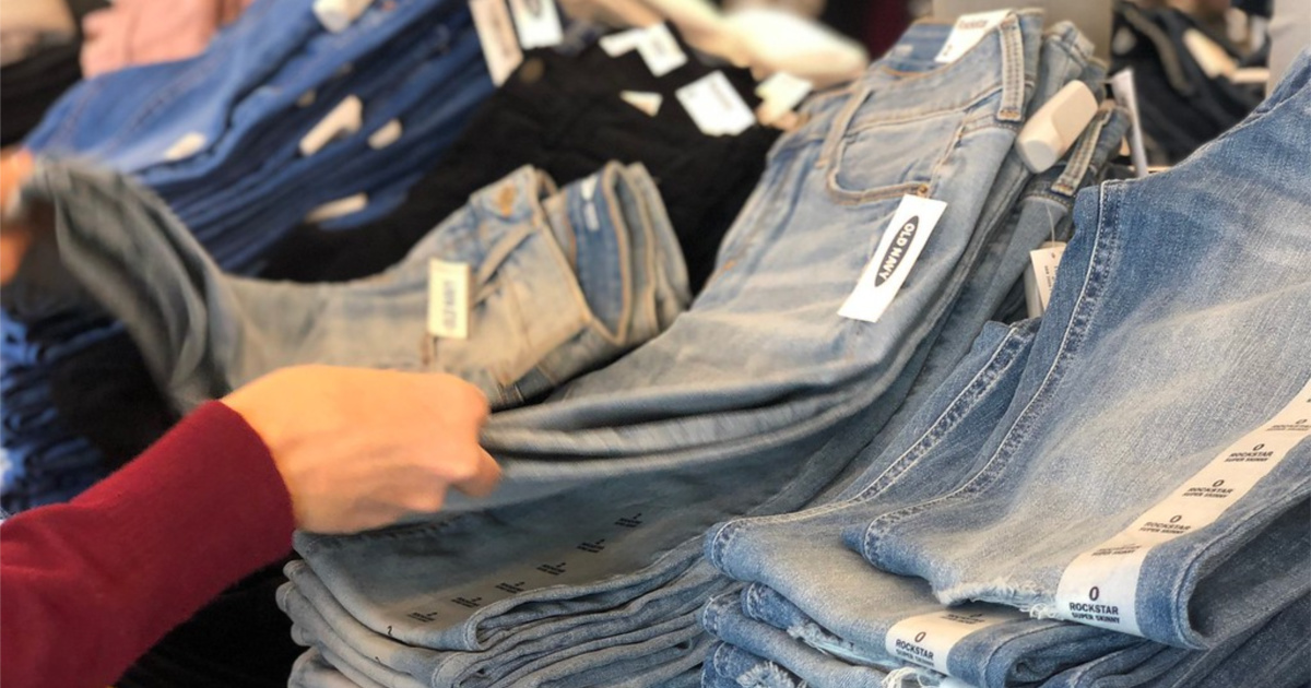 hands holding a pair of jeans