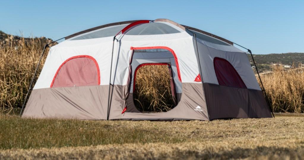 ozark trail 14 person tent in grassy area
