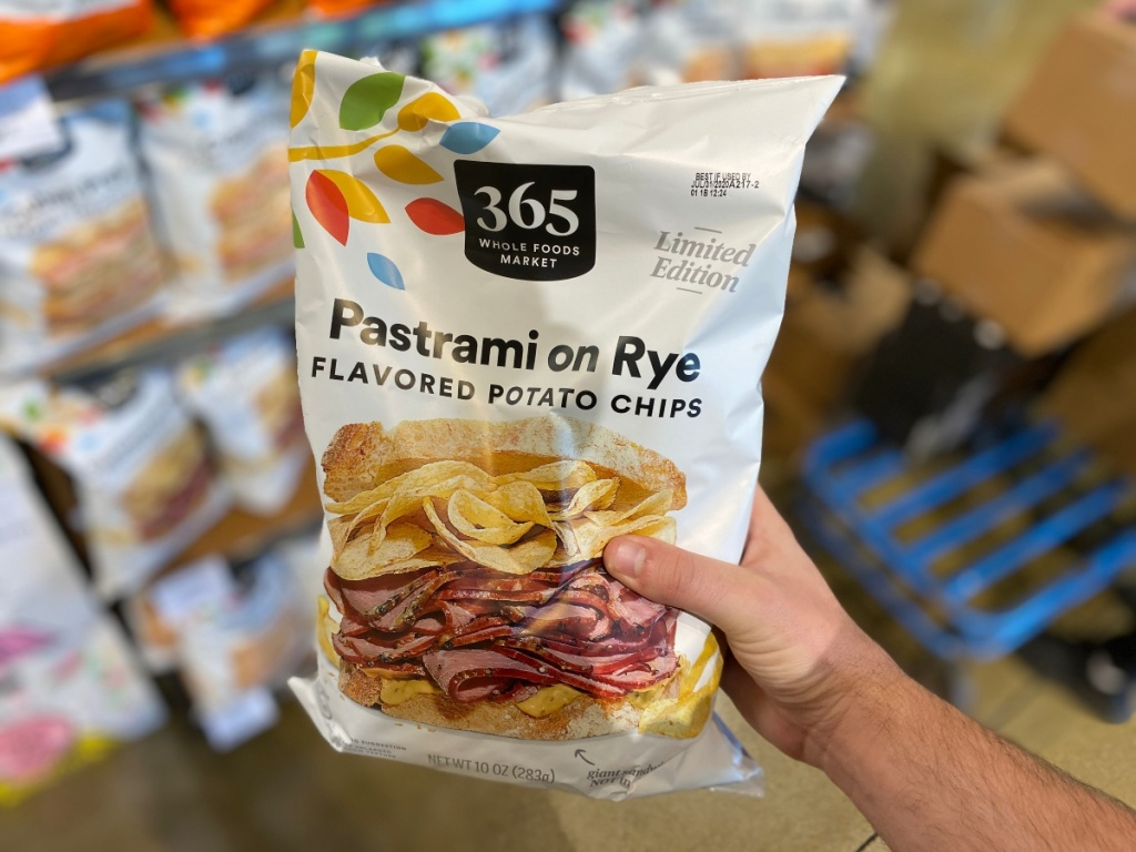 hand holding bag of Pastrami on Rye Chips