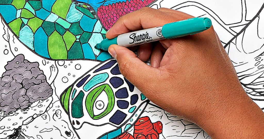 person coloring with sharpie marker