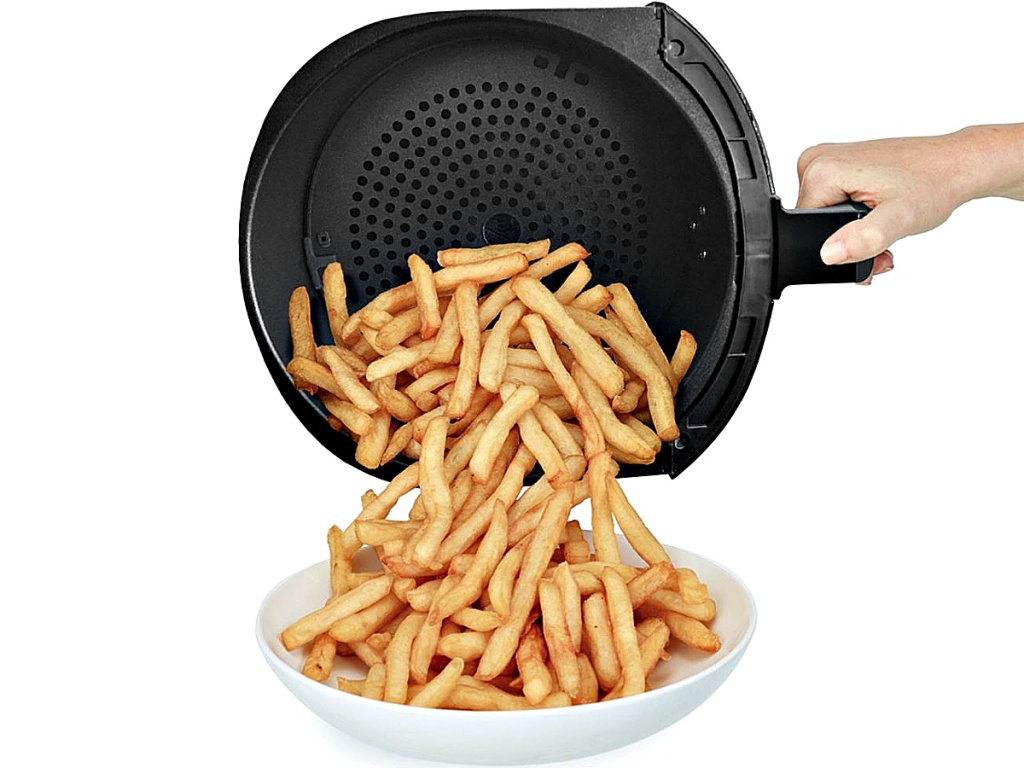 person pouring french fries from a Bella Pro Series 4.5-Quart Air Fryer