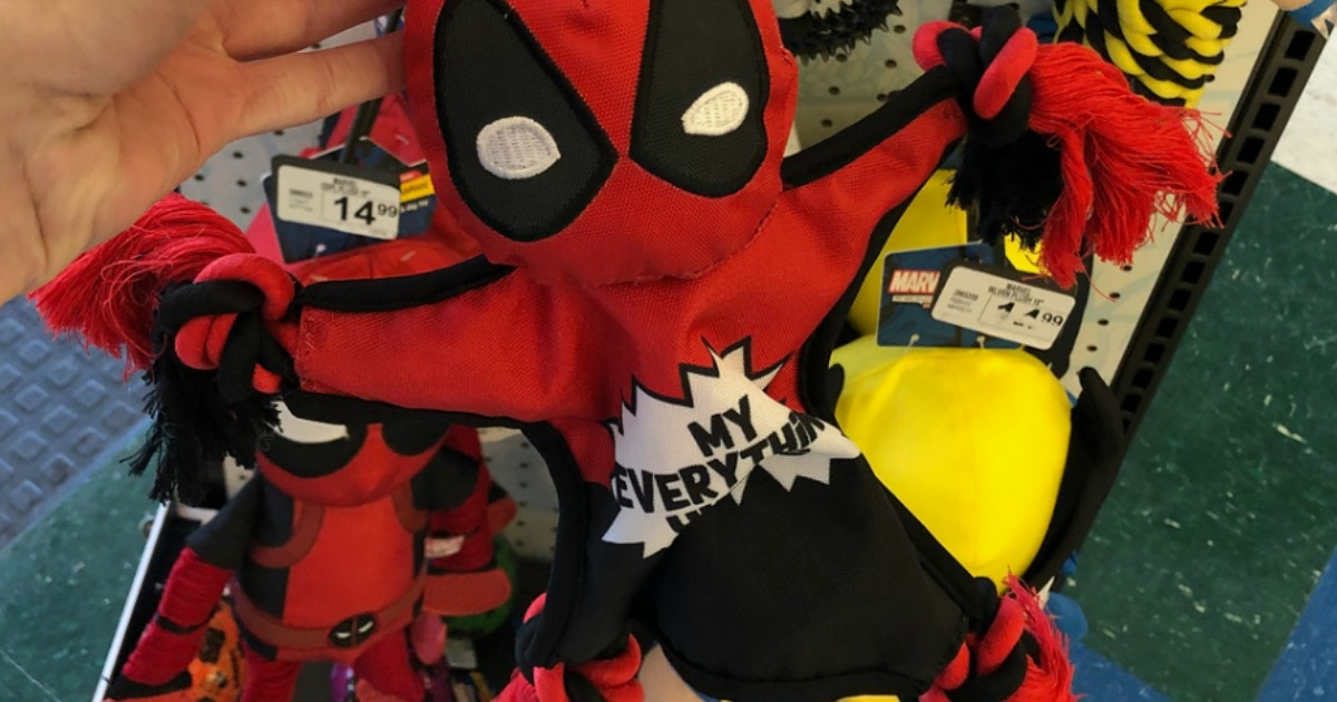 deadpool dog toy held in hand at store