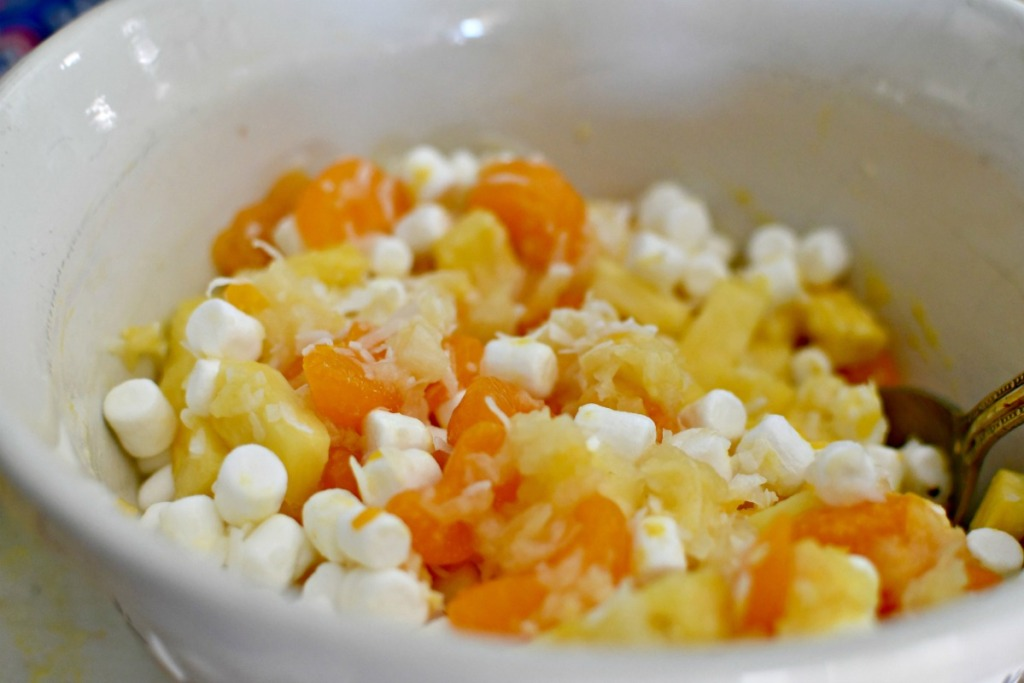 pineapple fluff salad ingredients in a large mixing bowl