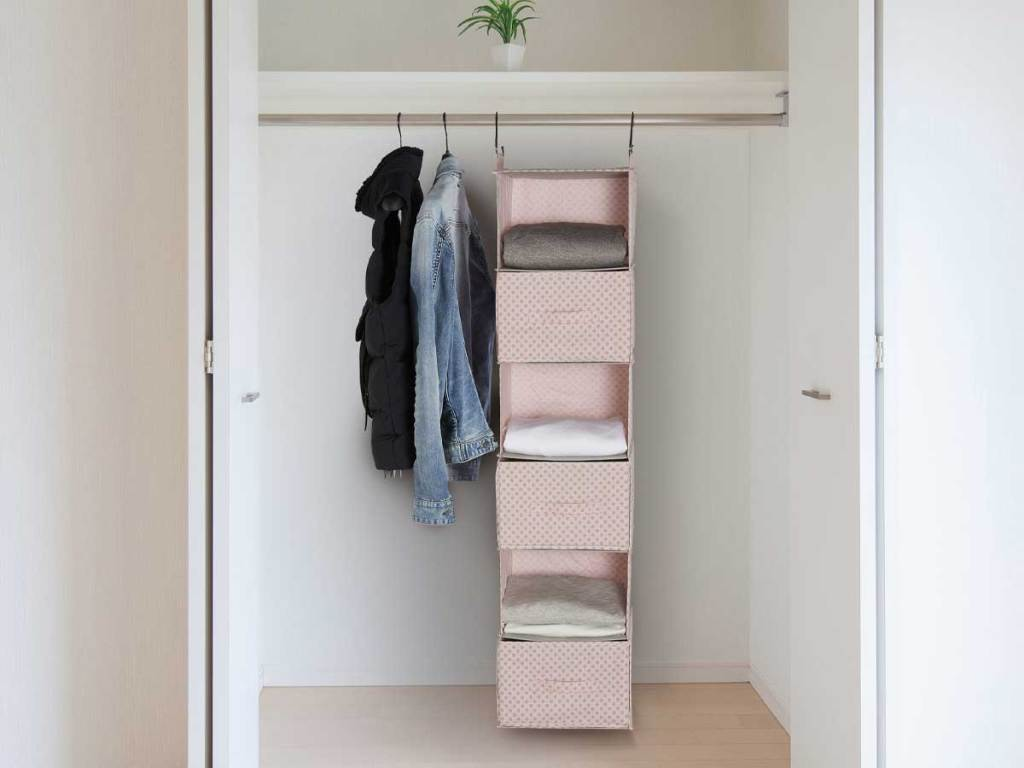 complete hanging bin holder with drawers inside a closet