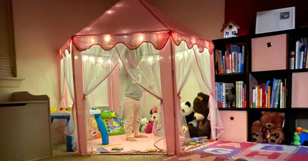 pink kids play tent with lights in bedroom