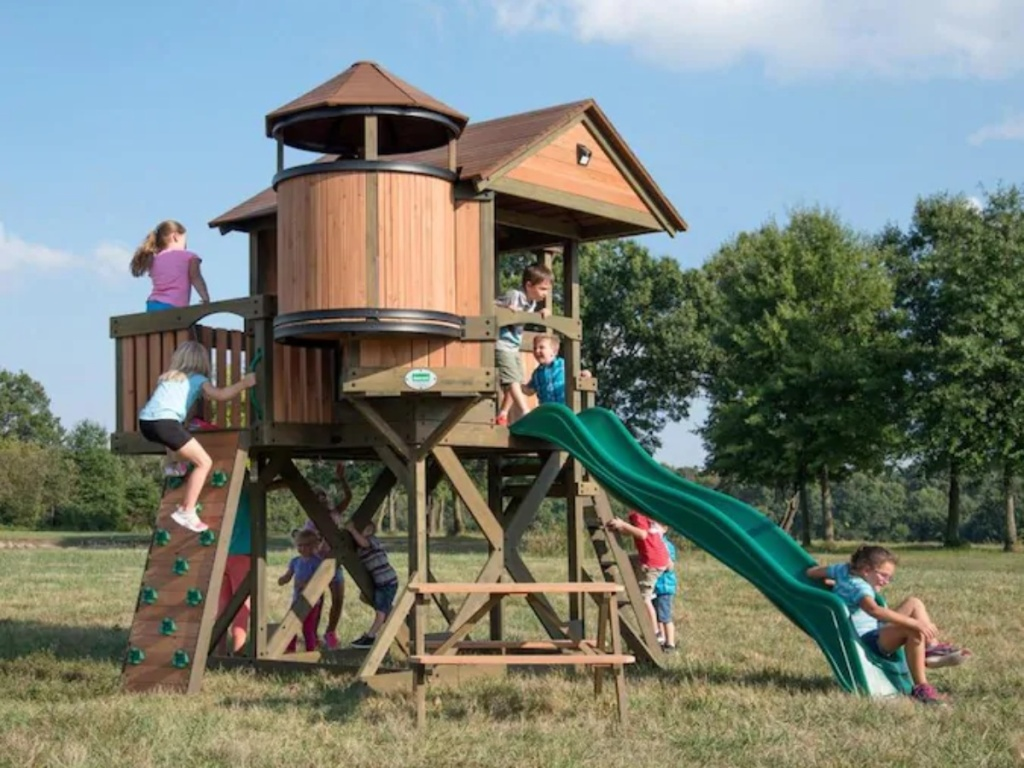 kids playing on elevated playhouse