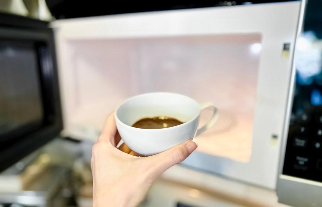 putting mug cake into microwave