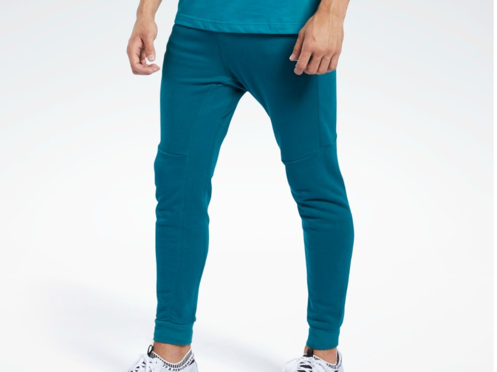 man wearing teal colored pants