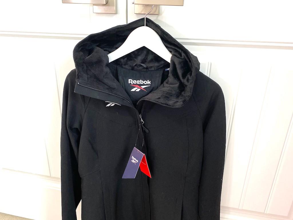 reebok jacket hanging on closet door