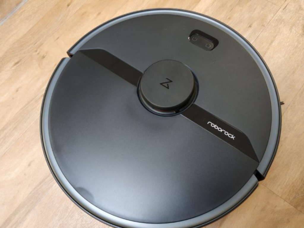 black robot vacuum with roborock logo