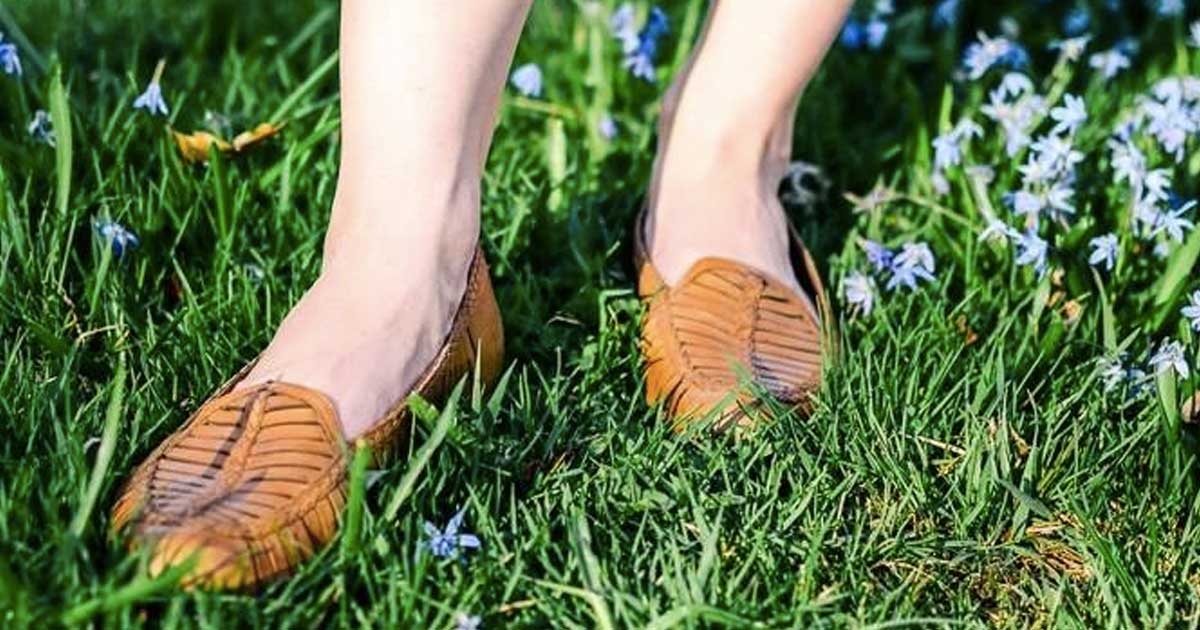 woman wearing sandals in the grass