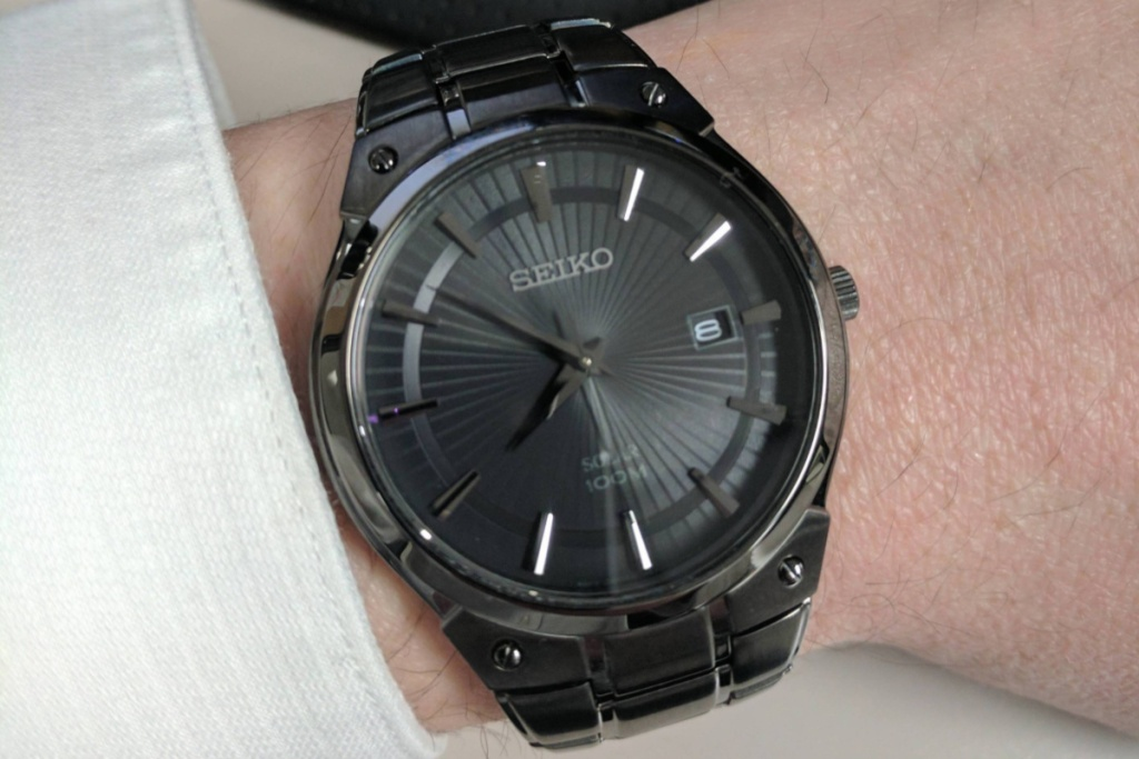 seiko black stainless steel watch on wrist