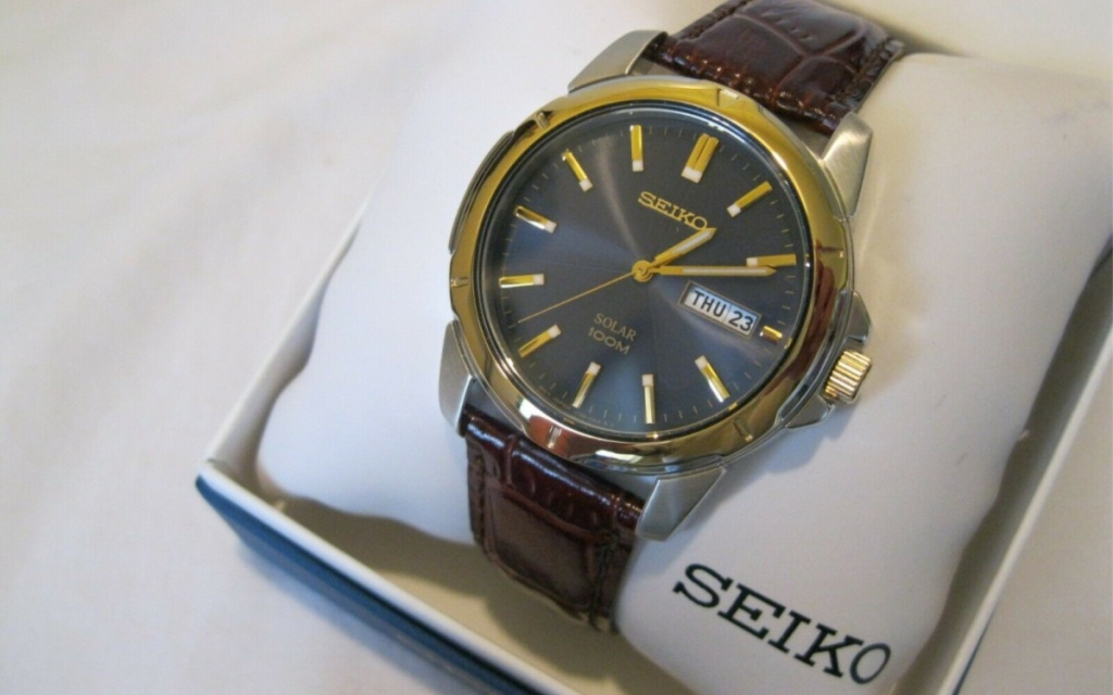 seiko brown leather strap watch on pillow