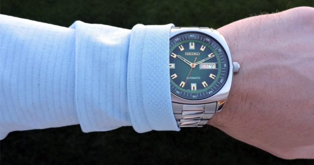 seiko mens green analog watch on arm