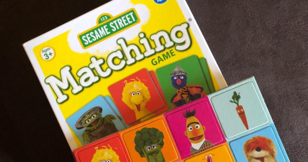 sesame street matching game with game pieces on top