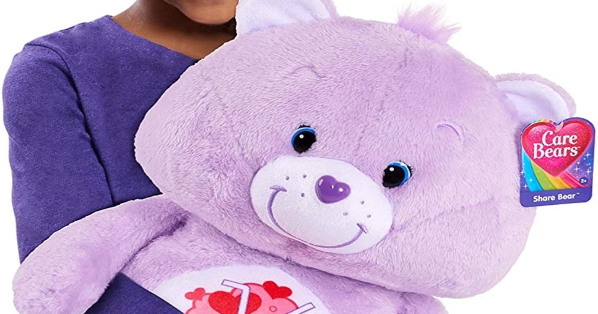 Purple Share Bear Care bear, held by girl in a purple shirt