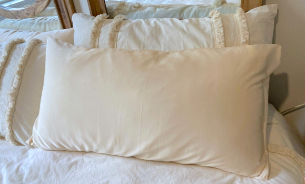 white fluffy pillow with cover on bed