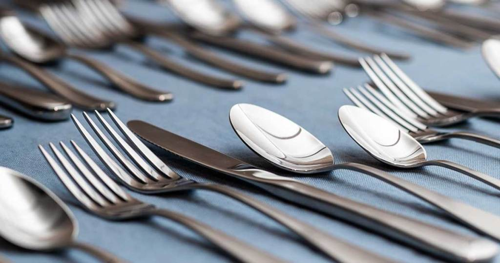 close up picture of silverware set laid out on table