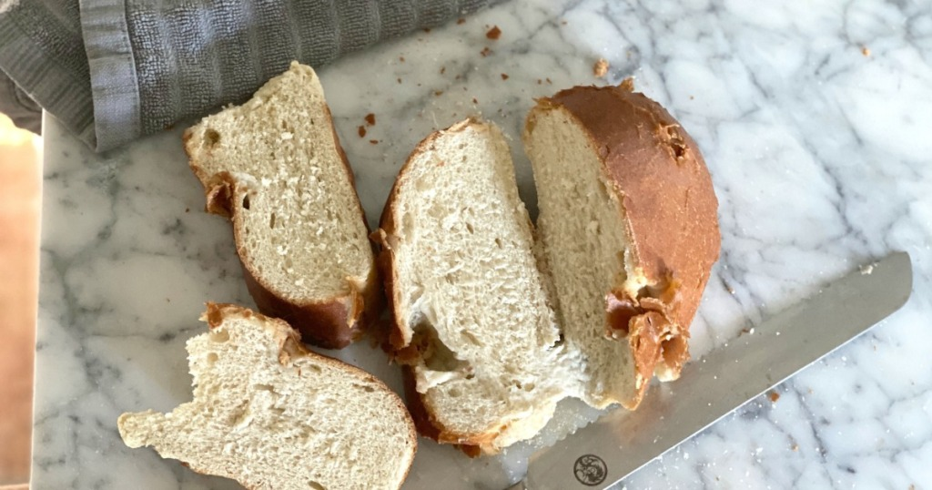 slicing revived french loaf of bread