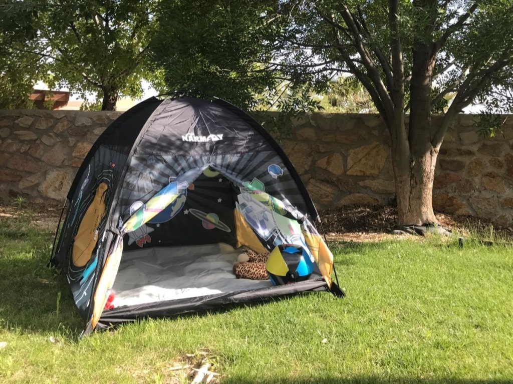 Space dome tent in a backyard