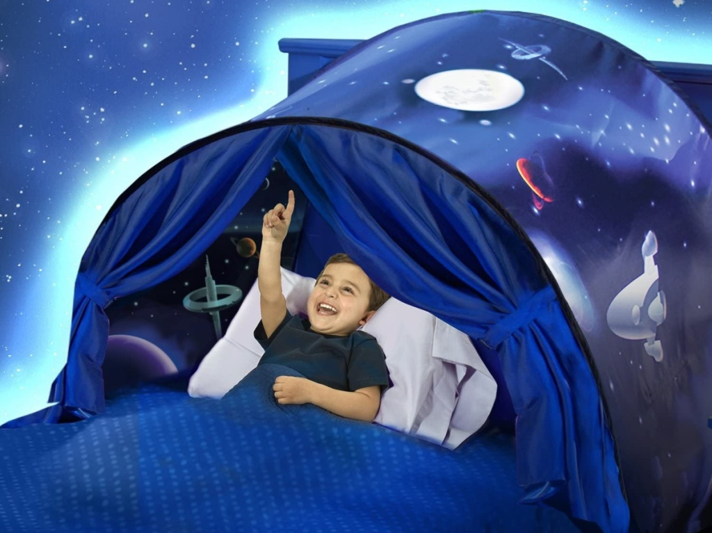 boy inside space tent