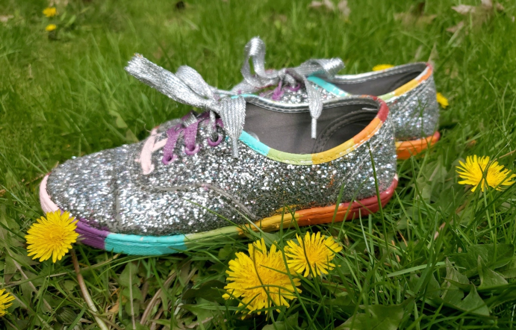 pair of shoes sitting in grass