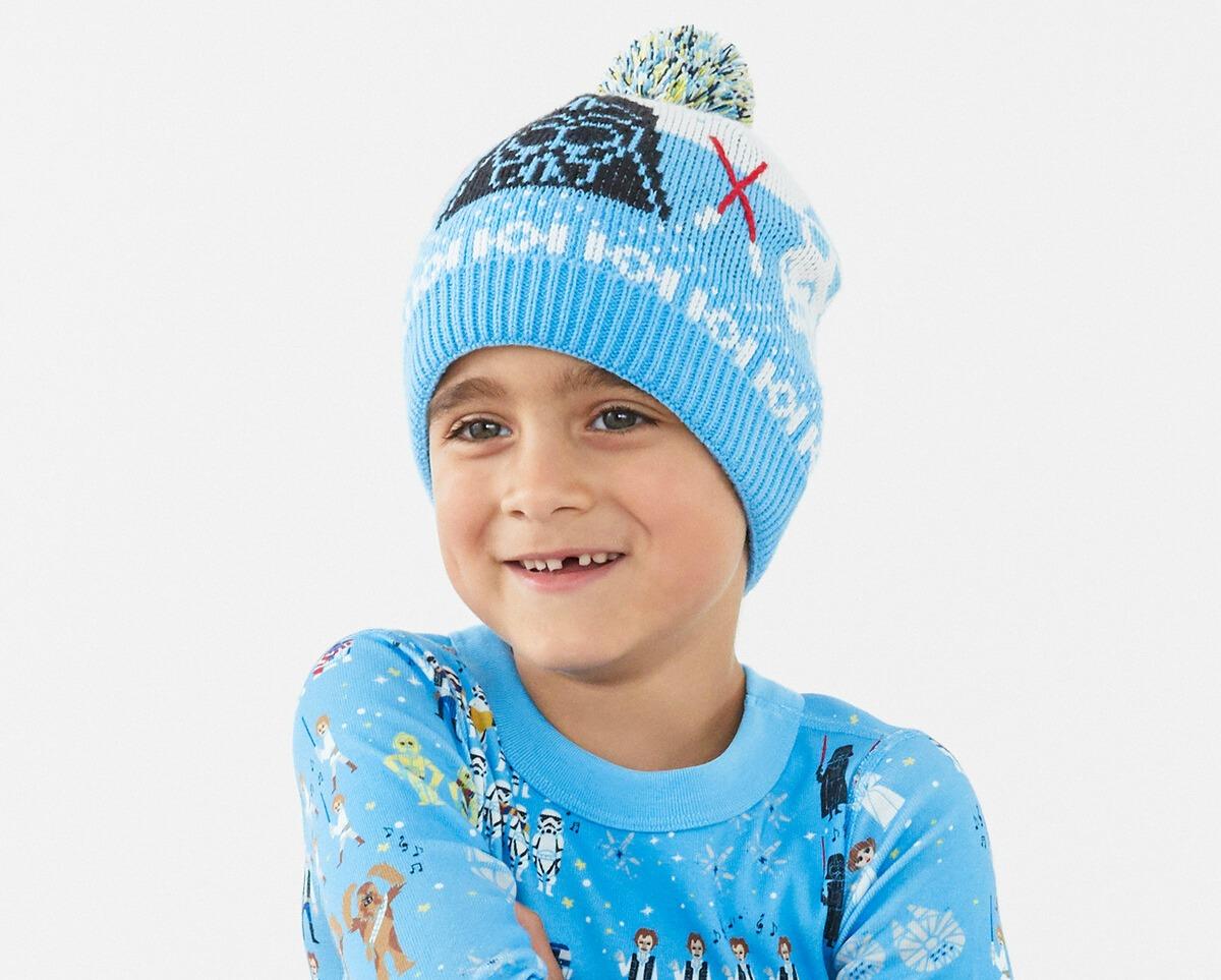 boy wearing a knit winter hat and PJs