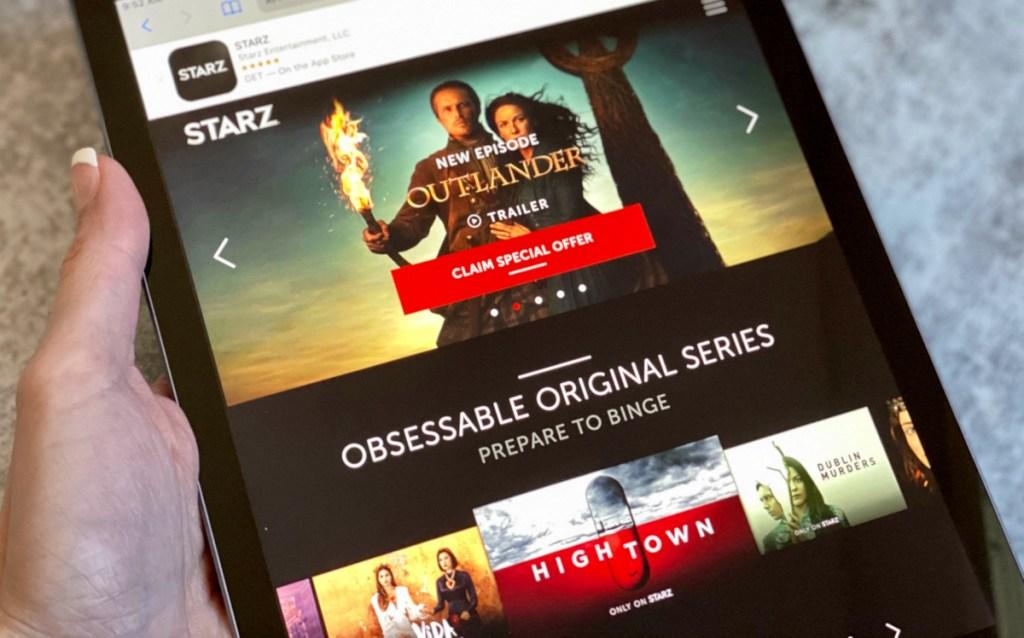 hand holding ipad with Starz app