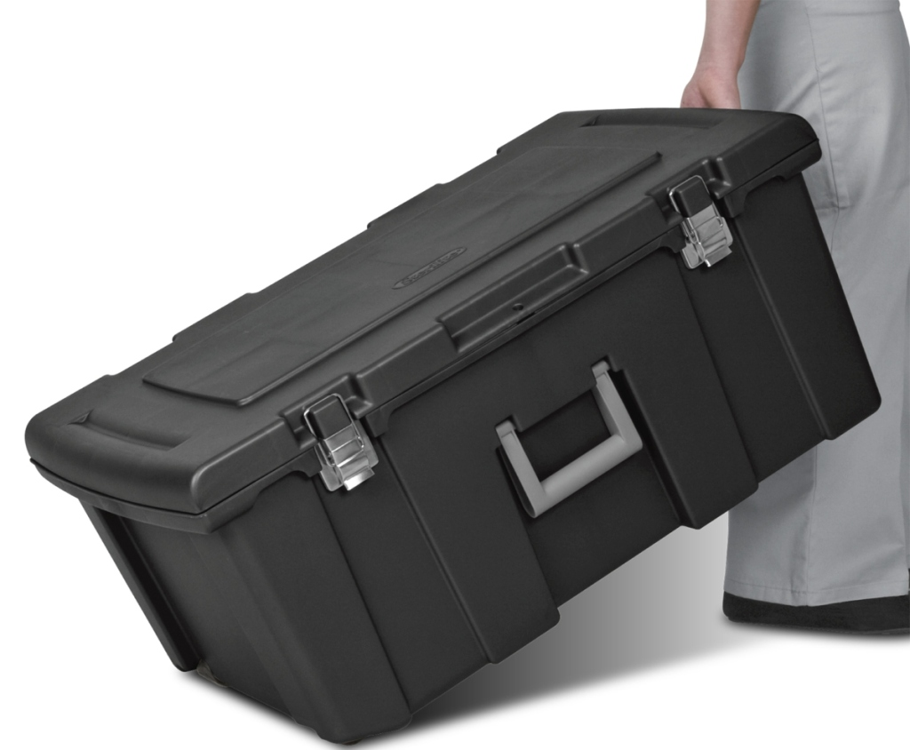 black sterilite tote, being moved by a person. They are holding it with one hand