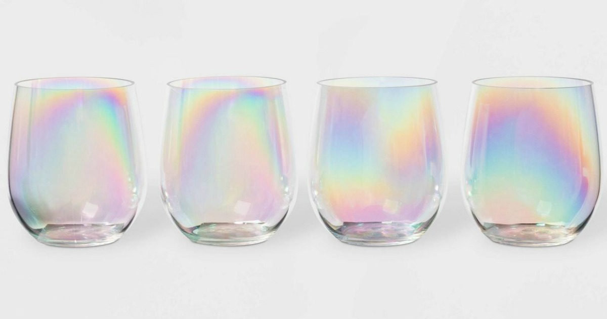 4 iridescent stemless plastic wine glasses in a row