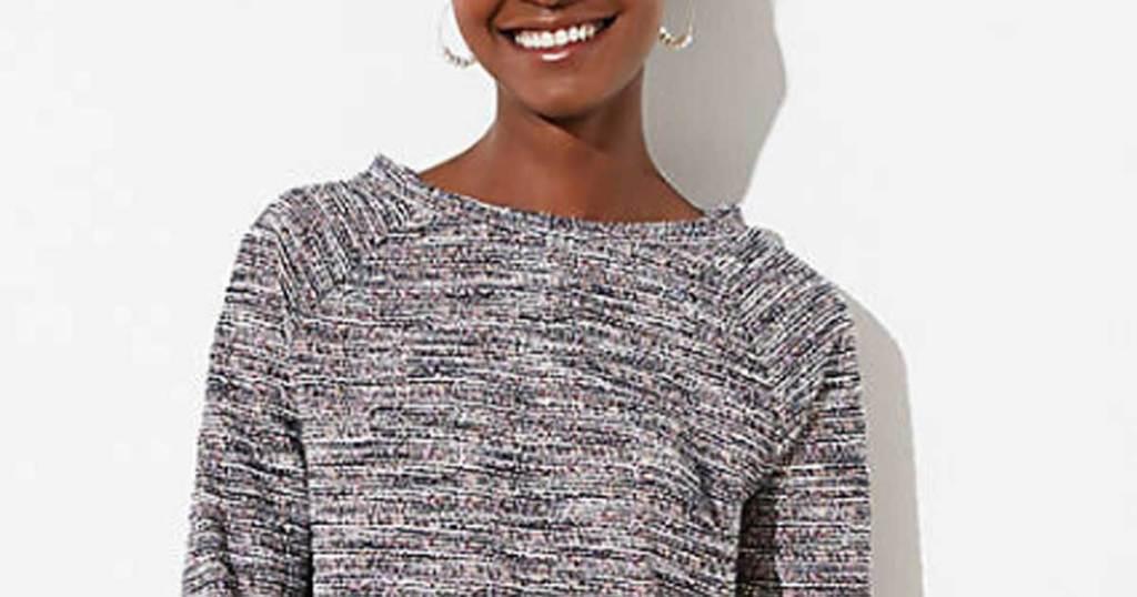 woman wearing sweatshirt laughing