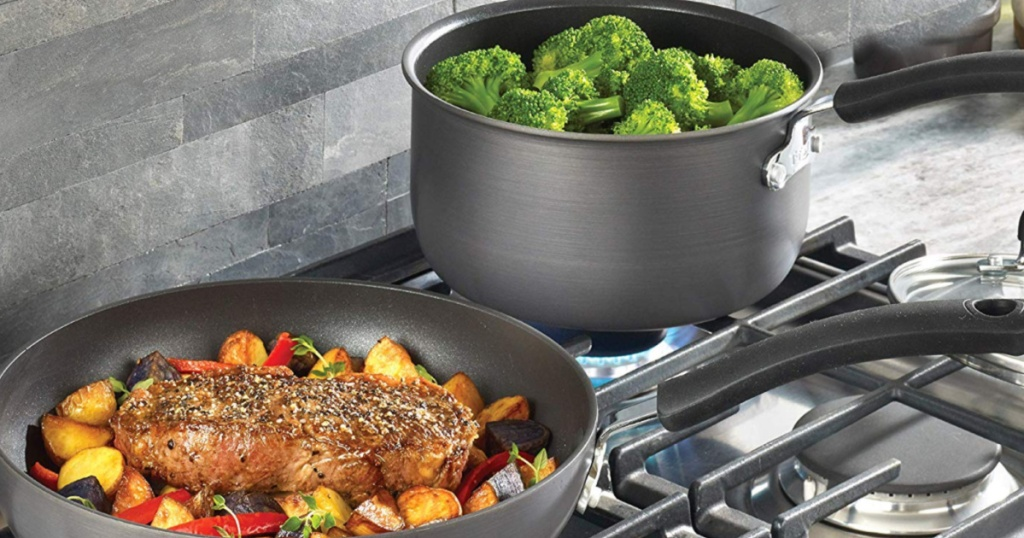t-fal two pans on stove with food cooking
