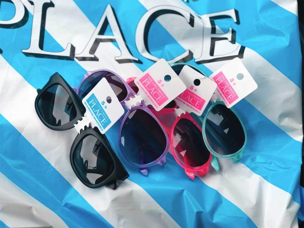 tcp sunglasses on a bag