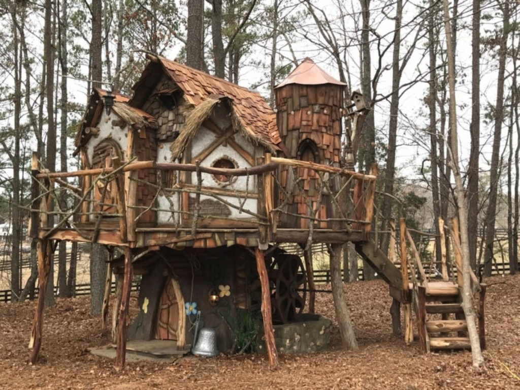 fairy tale tree house in wooded area