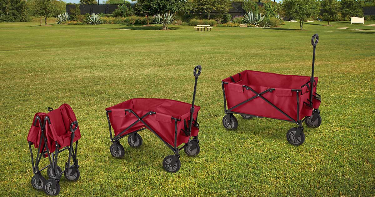 red utility wagons on a grass field in various stages of folding