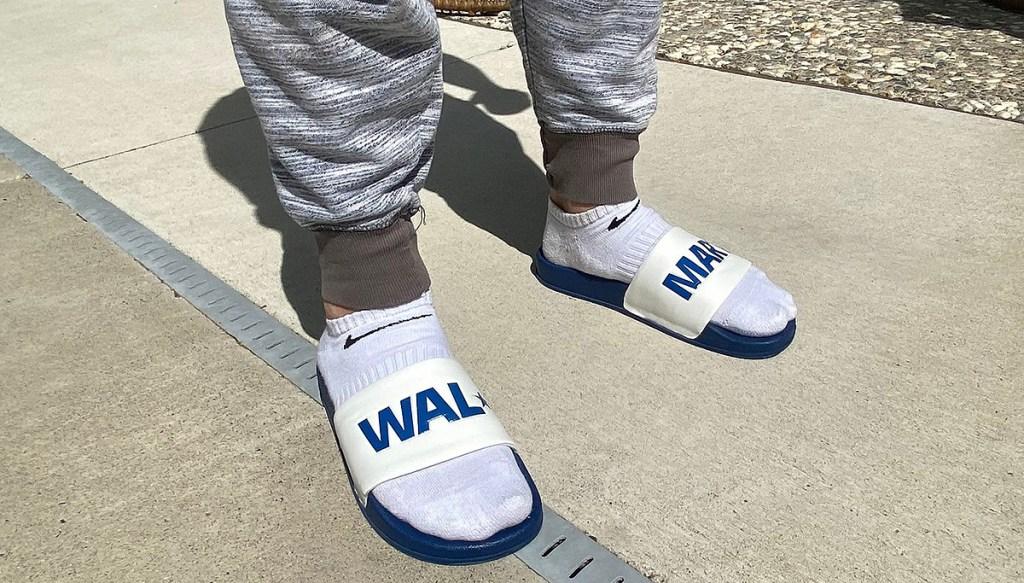 man wearing socks with walmart slides