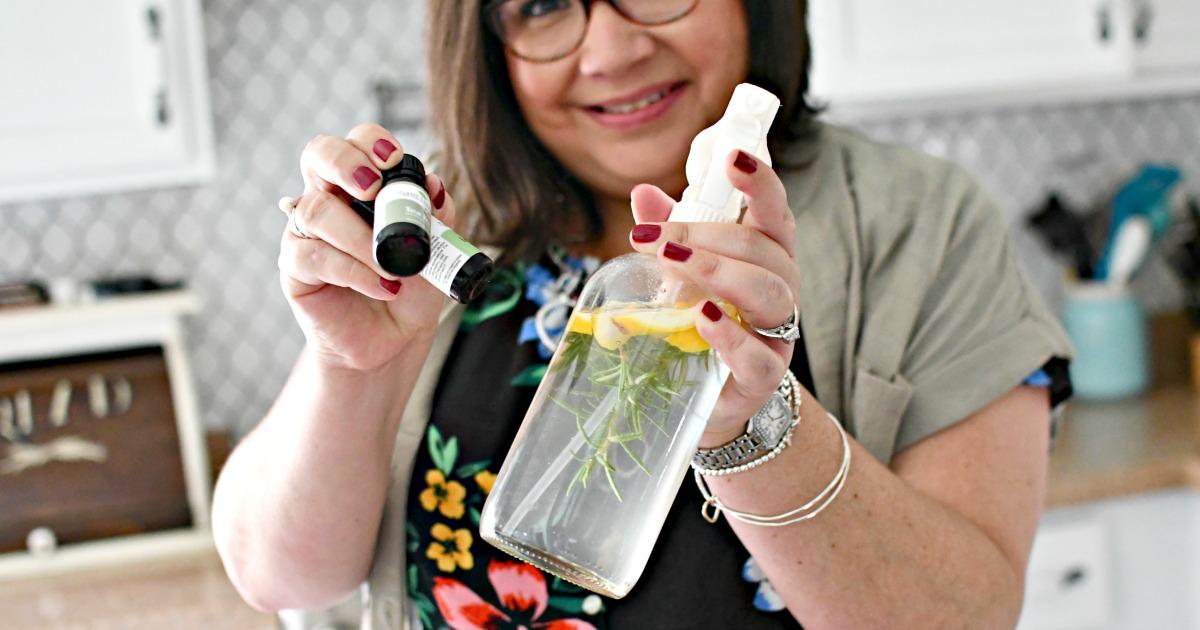 woman holding DIY Vinegar Cleaner