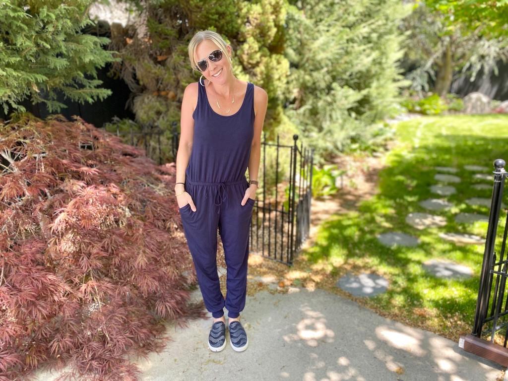 woman wearing blue jumpsuit outside