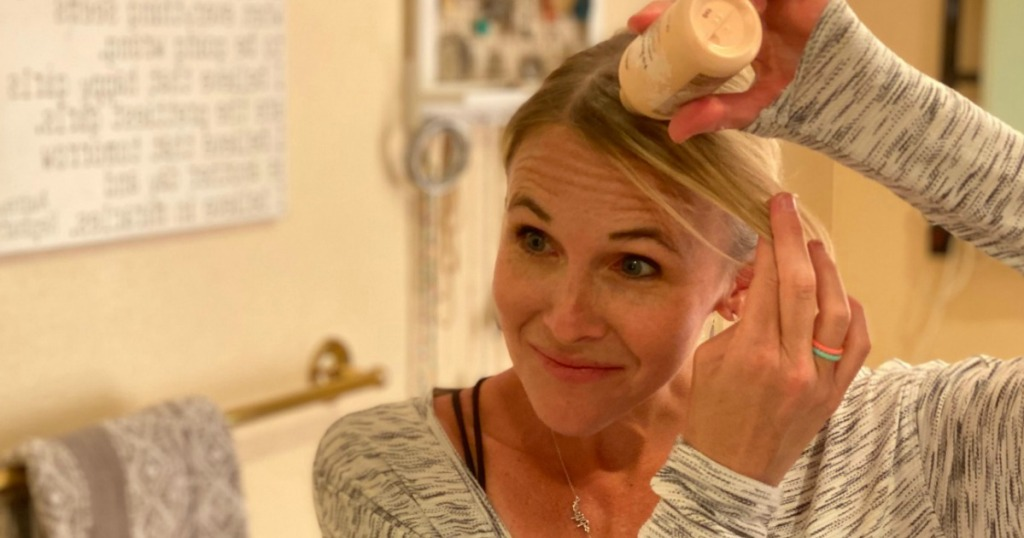 woman putting Bumble & Bumble dry shampoo powder on her hair