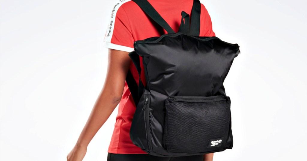 woman wearing Reebok Active Enhanced Backpack
